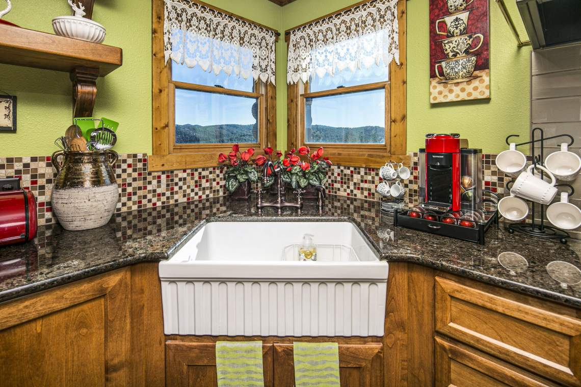 Deep Kitchen Sink and Custom Glass-Tile Backsplash with a View of the Mountains.