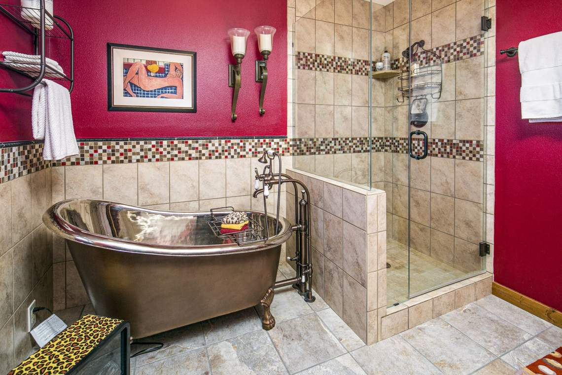 Master Bathroom with Copper Clawfoot Bathtub and Ceramic Tile Stand-Up Shower.