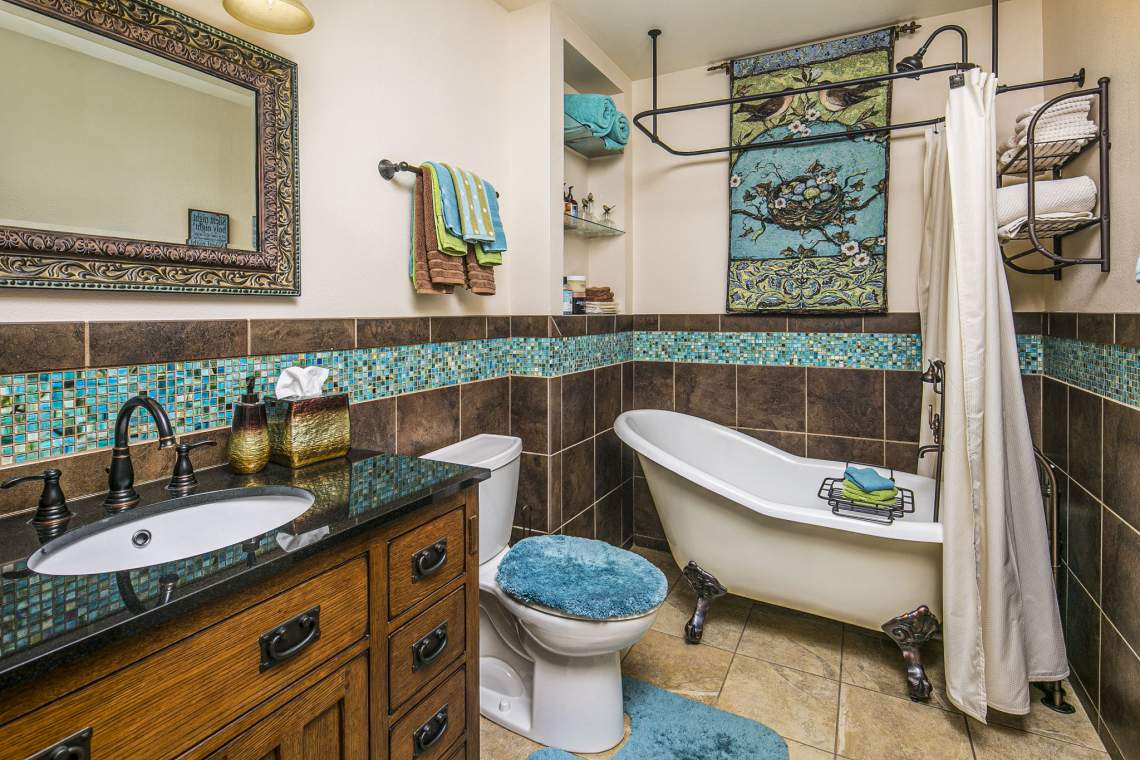 Shared Guest Bathroom in Upstairs Hallway with Clawfoot Bath and Shower.