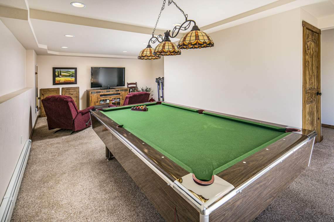 Spacious Recreation Room in Basement Includes Pool Table!