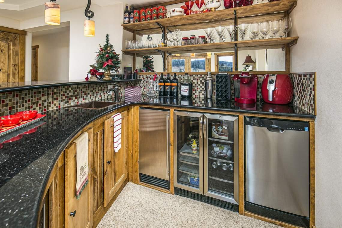 Custom Built Half-Round Bar with Black Galaxy Granite Counters, Wine Fridge, Dishwasher, and Custom Designed Shelf Brackets - Perfect for Entertaining!