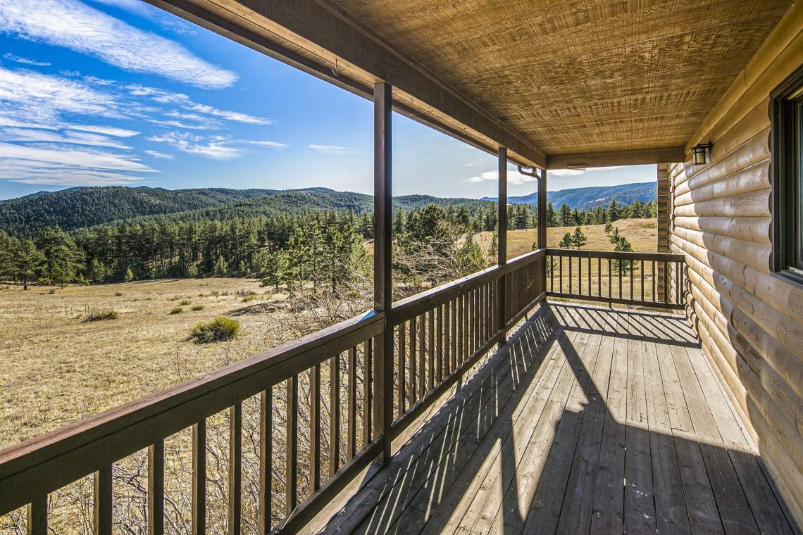 Enjoy the Gorgeous Mountain Scenery from the Comfort of the Wrap Around Porch!